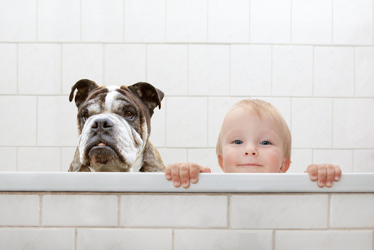 child and dog in the bathtub
