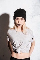 Vertical image of Serious Hipster woman in black hat