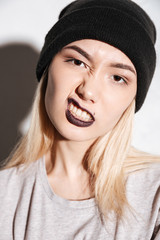 Vertical image of Young Hipster woman in black hat