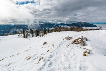 The view of Kamnik-Savinja Alps from the top of the snow covered Urslja gora mountain