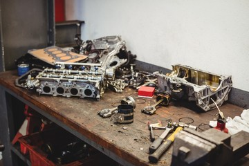 Workbench with car parts and tools