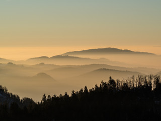 Morning before the sunrise above the low Morning before the sunrise above the low clouds viewed from Crnivec above Kamnik, Slovenia