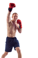 Full length portrait of young male boxer flexing muscles isolated over white background
