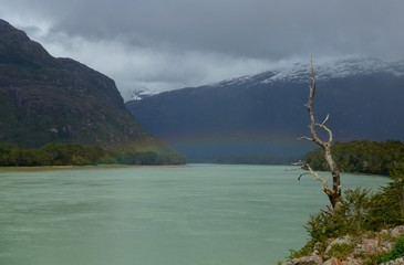Faint Rainbow over wide open rio Cochrane in Southern Chile, Patagonia