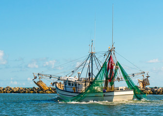 Shrimp boat going out to sea