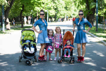 Aluminium Prints Indonesia twins mother with children in city park