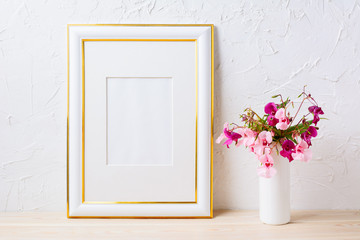 Gold decorated frame mockup with pink and purple flower bouquet