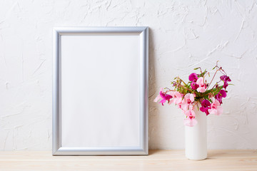 Silver frame mockup with pink and purple flower bouquet