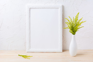 White frame mockup with ornamental grass in exquisite vase