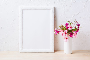 White frame mockup with pink and purple flower bouquet