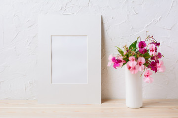 White mat frame mockup with pink and purple flower bouquet