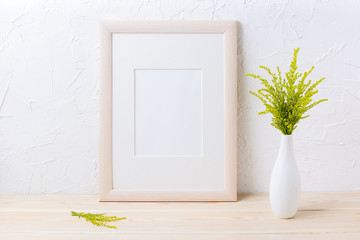 Wooden frame mockup with ornamental grass in exquisite vase