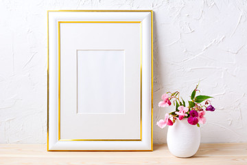 Gold decorated frame mockup with flower bouquet in flowerpot