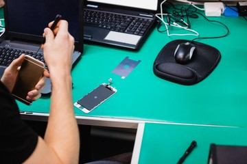 Man repairing mobile phone
