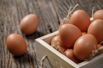 Fresh eggs in wooden box on wooden table, Chicken Egg