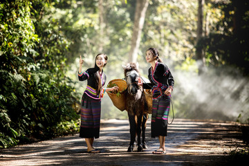Tribal people living Geum Mugabe in costume wearing a beautiful city in Laos.