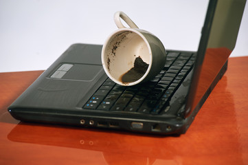 broken laptop filled coffee