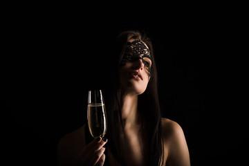 elegant lady portrait on black background dressed in mask and toasting