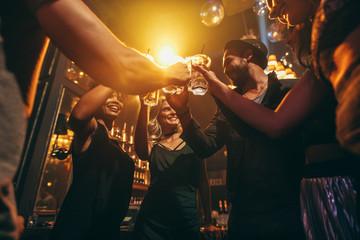 Group of friends enjoying drinks at bar