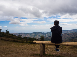 Young woman sitting on chair and see sky,sit  alone
