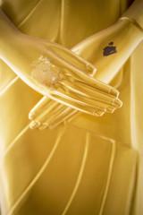 Peace concept, Golden Buddha sculpture hand