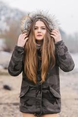 trendy girl in jacket outdoor cold