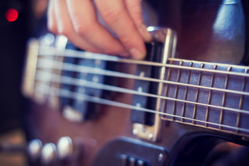To play bass guitar