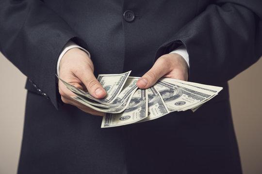 Businessman offering bribe