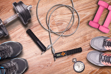 Endurance training on jump-rope. Fitness gym and equipment to training on wooden floor background. Running shoes and workout.