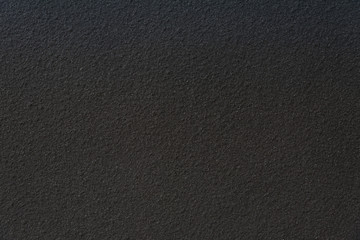 Black wall stone background.