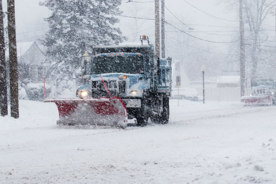 Snow plow plowing the streets