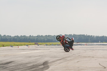 Red stunt bike wheelie