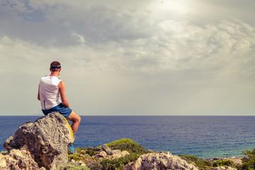 Man looking at beautiful ocean view, relaxing