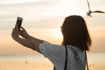 Woman were using phone camera