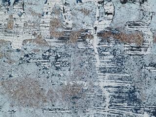 古いペンキが風化した壁