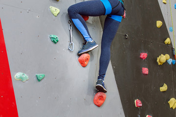 Foot and shoe of climber on artificial boulder