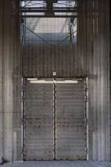 Metal security cage with gate