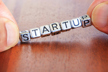 Start up business finance concept with metal letters
