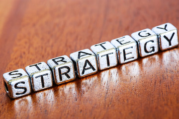 strategy concept business marketing letters placed on a desk in precious wood