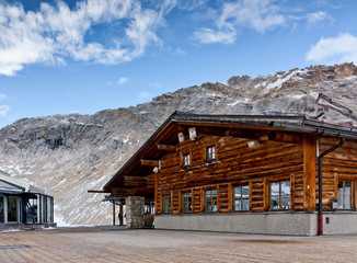 Wall Mural - Wooden alpine cafe at Zugspitze, Bavarian Alps. Popular ski resort in Bavaria. Rack railway station.