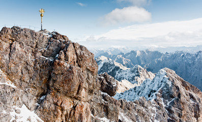 Wall Mural - Sign on the top of Zugspitze mountain. Famous landmark in Bavaria. The highest mountain in Germany. Clear sunny day in highlands of the Alps. Snow peaks of the mountains.