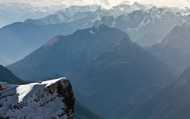 Wall Mural - Fantastic view from Zugspitze mountain to the cross on the climb.