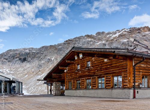 Wall mural Wooden alpine cafe at Zugspitze, Bavarian Alps. Popular ski resort in Bavaria. Rack railway station.
