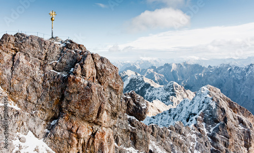 Wall mural Sign on the top of Zugspitze mountain. Famous landmark in Bavaria. The highest mountain in Germany. Clear sunny day in highlands of the Alps. Snow peaks of the mountains.