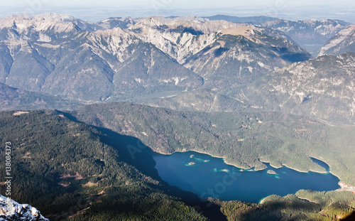 Wall mural Aerial view from Zugspitze mountain on the lake Eibsee. Alpine lake from the top.