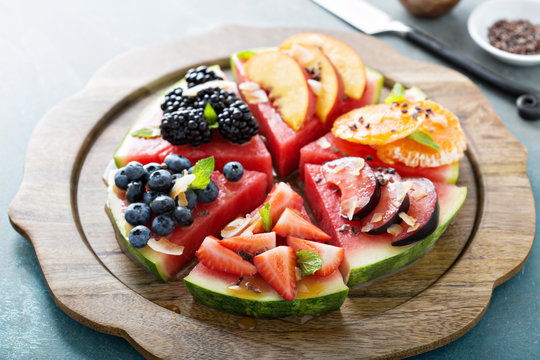 Watermelon pizza with various fruts