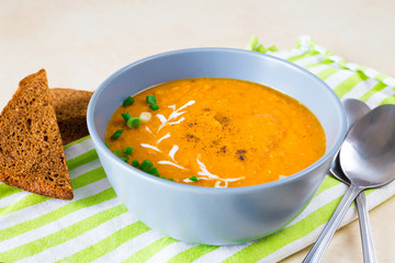 Red lentil mixed vegetable puree soup with carrot