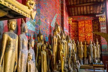 Buddha statues in Wat Xieng Thong in Luang Prabang
