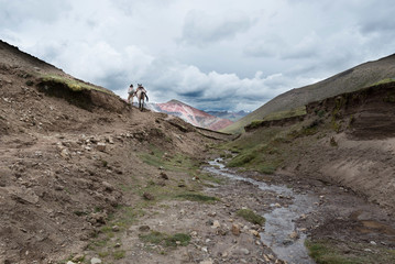 A Quechuan man and his horse on the Peruvian Andes. The horses are generally used to help hikers up the mountains.