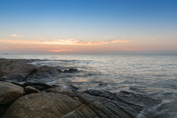 Beautiful sky in the sea with rock and wave seascape